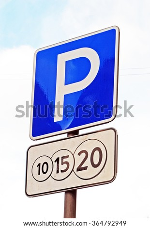 Paid parking road sign on light background