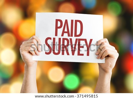 Paid Survey placard with bokeh background - stock photo
