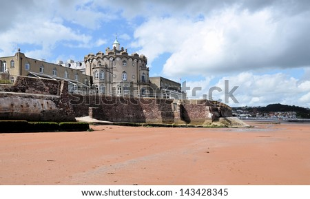 PAIGNTON, UK - JUNE 22. The Redcliffe Hotel on June 22, 2012, originally built as a home with an Indian theme in 1856, located on a promontory with red sandy beaches in Paignton, Devon, England, UK. - stock photo