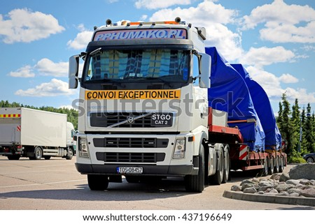 PAIMIO, FINLAND - JUNE 12, 2016: Volvo FH truck with two industrial objects on trailer as oversize load iis parked on a truck stop in South of Finland.  - stock photo