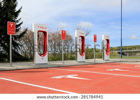 PAIMIO, FINLAND - MAY 14, 2015: Recently opened Tesla Supercharger station in Paimio. The cost for using the charger has been covered with the purchase of the car. - stock photo