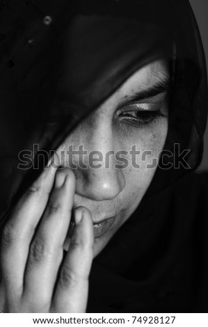 Pain, abused woman crying in dark - stock photo