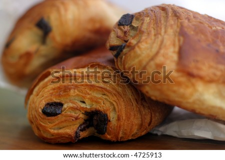 Pain au Chocolat - A croissant filled with chocolate! Tasty and delicious traditional French breakfast pastry, fresh from the bakery. - stock photo