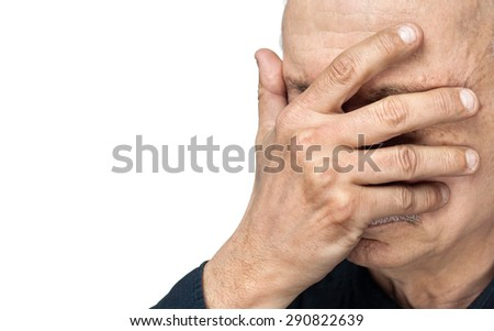 Pain. Elderly man covers his face with hand isolated on white background with copy-space