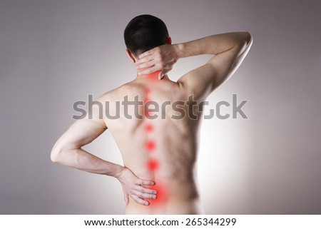 Pain in a body of the man on gray background. Red dot - stock photo