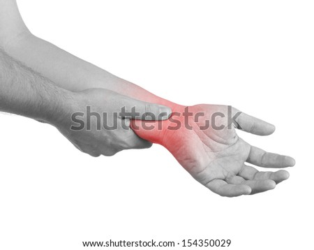 Pain in a man wrist. Male holding hand to spot of wrist pain.  - stock photo