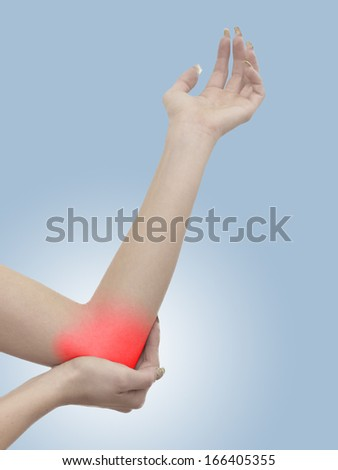 Pain in a woman elbow. - stock photo