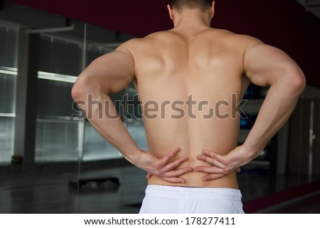 Pain in back.Sport injury or another pain concept - stock photo