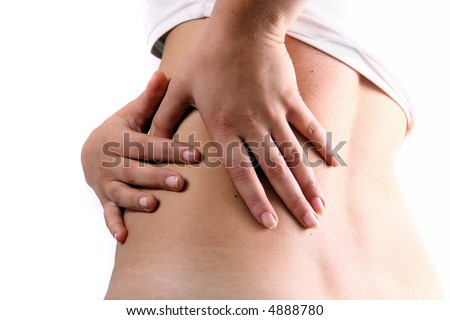 Pain in the back A young woman holds her back in pain! - stock photo