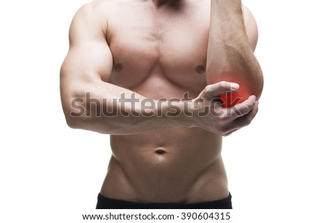 Pain in the elbow. Muscular male body. Isolated on white background with red dot - stock photo