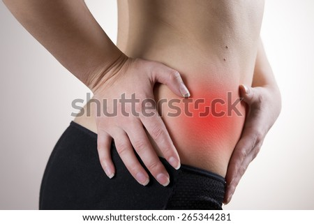 Pain in the right side of the woman. Attack of appendicitis. Red dot. - stock photo