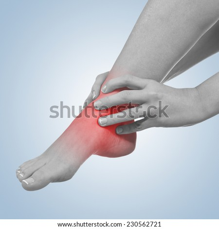 Pain in woman hamstring. Female holding hands on spot pain hamstring. - stock photo