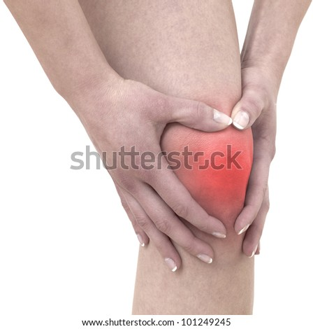 Pain in woman knee. Concept photo with read spot indicating pain. Isolation on a white background - stock photo