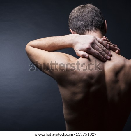 Pain neck. The back man.Black background - stock photo