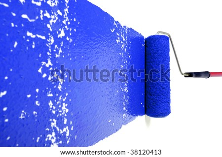 Pain roller with blue paint on white wall - stock photo