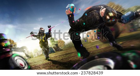 Painball team in action. Woman team win, sunny day location - stock photo