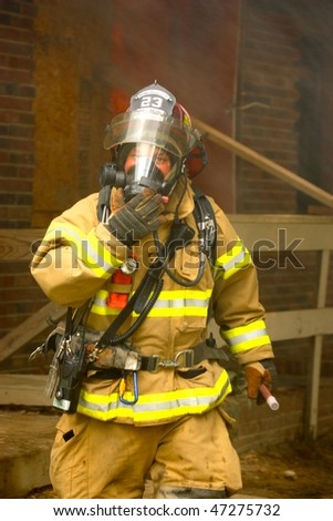 PAINESVILLE - OCTOBER 15: Firefighters fighting fire during training on October 15, 2009 in Painesville, Ohio