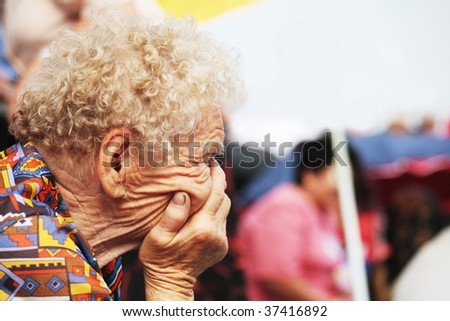 Painful and sad moment for an older woman - stock photo