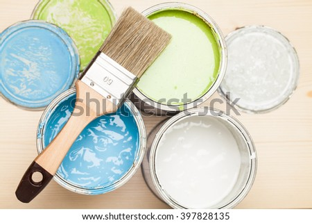 Paint and brush on the Pine wooden background with copy space - stock photo