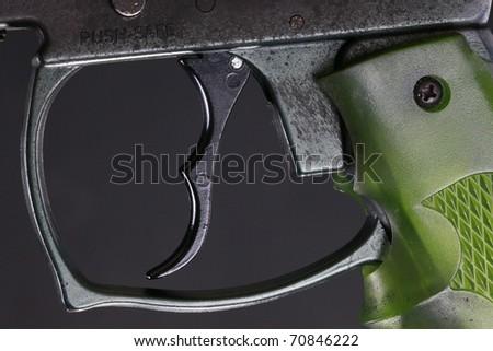 Paint ball gun trigger and soft grip - stock photo