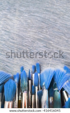 Paint blushes in blue tone - stock photo