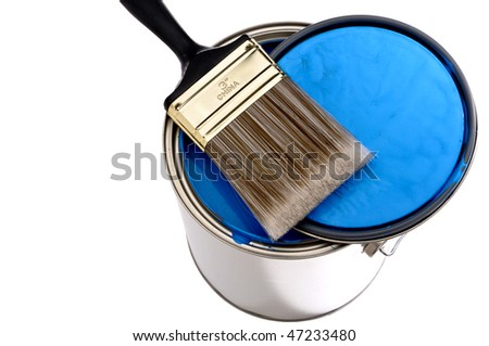 Paint brush and lid on top of a can of blue  paint - stock photo