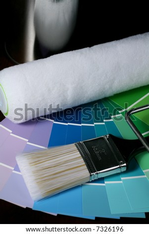 Paint Brush and Roller with Color Swatches. - stock photo
