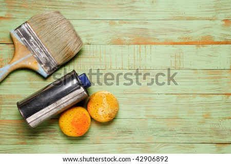 paint brush and tool on green wooden background - stock photo