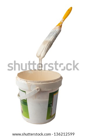 Paint brush dripping in the container isolated on white