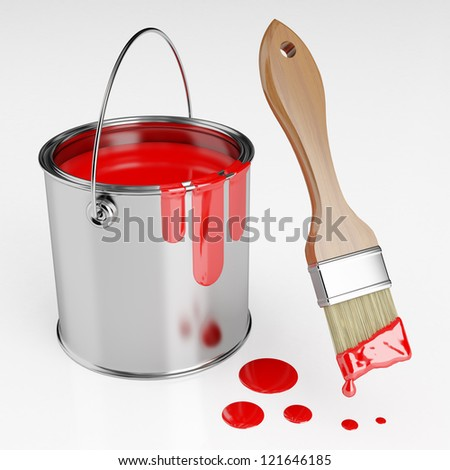 Paint brush next to a can of red paint - stock photo