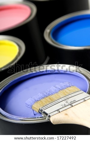 Paint brush on paint cans - stock photo