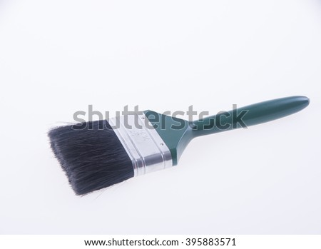 paint brush or green paint brush on a background