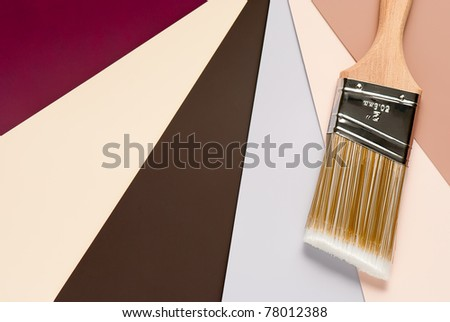 Paint brush over color choices background - stock photo