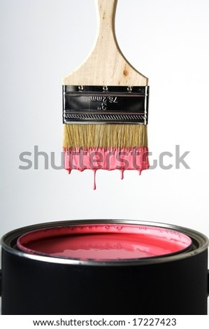 Paint Brush over Paint can - stock photo