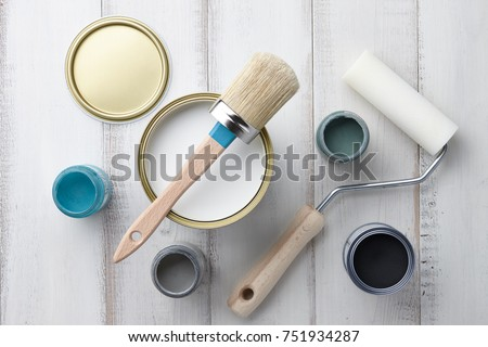 https://thumb7.shutterstock.com/display_pic_with_logo/3049574/751934287/stock-photo-paint-brush-sponge-roller-paints-waxes-and-other-painting-or-decorating-supplies-on-white-wooden-751934287.jpg