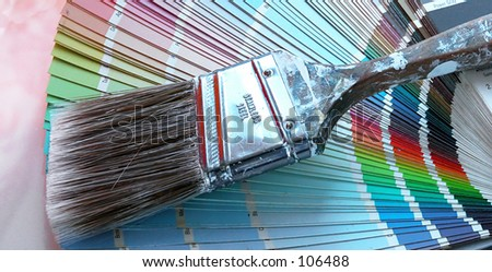 Paint brush with paint samples - stock photo