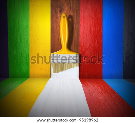 Paint brush with white paint stroke on wood - stock photo