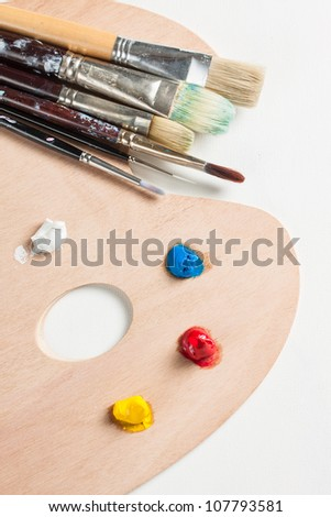 Paint brushes and paint on a palette