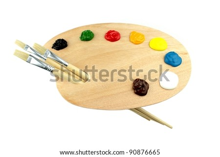 Paint brushes, colors and artist palette - stock photo