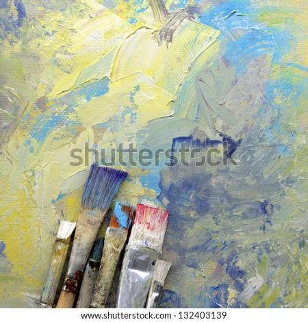 paint brushes lying on painted background - stock photo