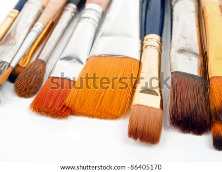 paint brushes on a white background. - stock photo