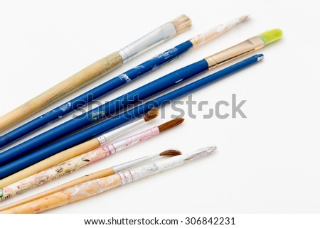 Paint brushes on art water color paper - stock photo