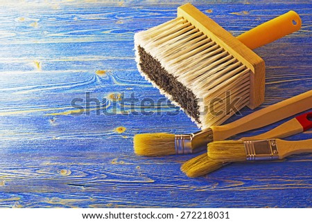 Paint brushes on the table - stock photo