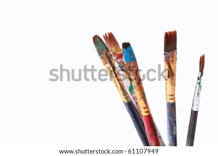 Paint brushes on white - stock photo