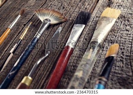 Paint brushes used by artists to create paintings - stock photo