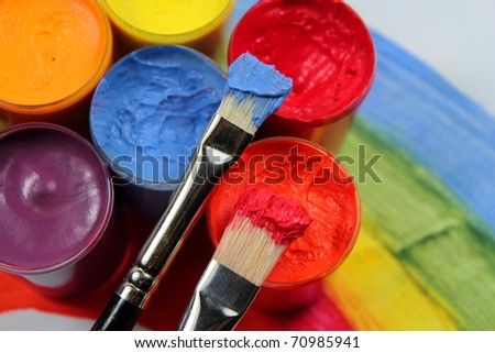 Paint brushes with opened paint buckets - stock photo