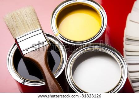 Paint buckets, paint and brush - stock photo
