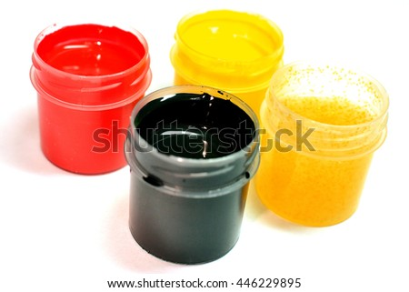 Paint buckets with various colored paint - stock photo