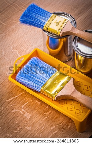 paint can brushes tray on wooden board construction concept  - stock photo