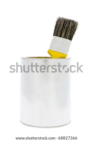 Paint can with a yellow brush isolated on white background - stock photo